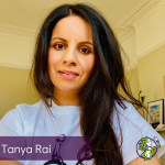 Headshot of Tanya Rai, smiling into the camera wearing 'Love Wins' t-shirt by Charlie Mackesy.